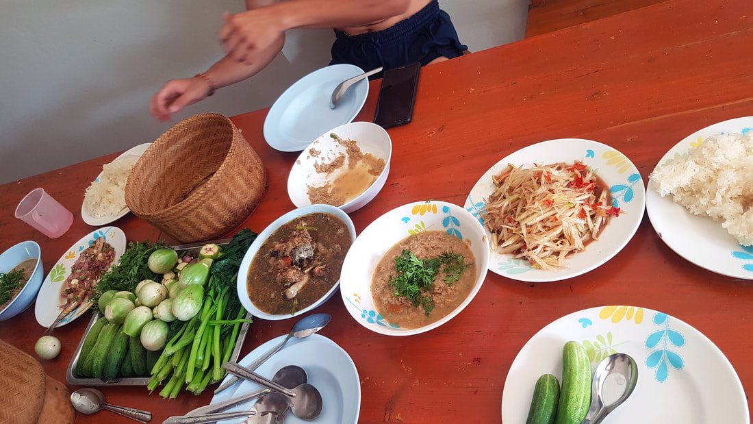 Kaen No Mai (pork bamboo soup) or Tom Hua Pla (Laos style fish head soup)